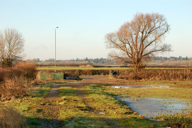 Footpath meets the road to HMP Onley