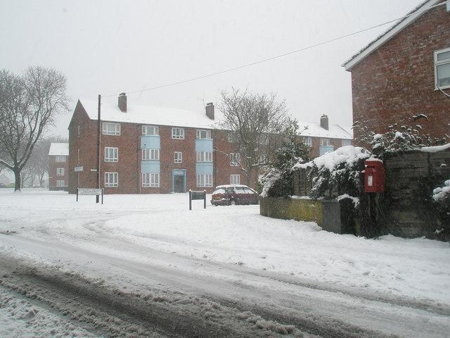 Snow covered postbox in Stockheath Lane