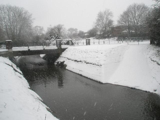 A snowy scene at the bridge in Stockheath Lane