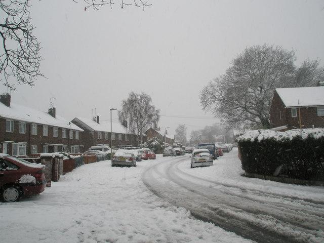 Bend in a snowy Woodgreen Avenue