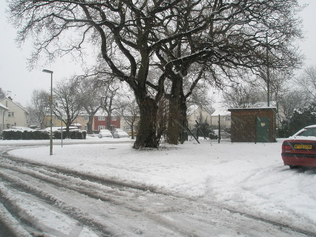 Junction of a snowy Woodgreen Avenue and Barncroft Way