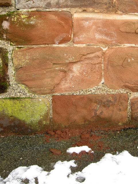 Damaged bench mark below Pemberton's Parlour