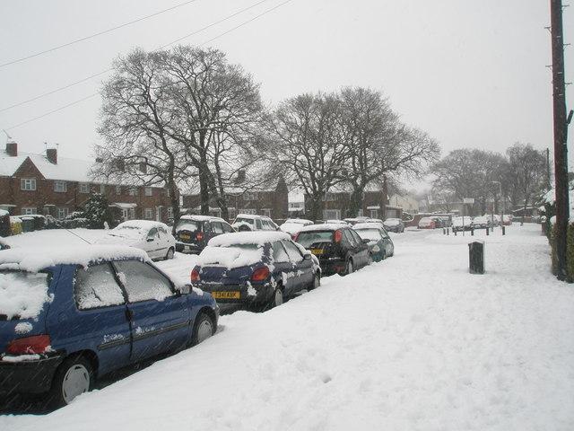 Snowy pavement in Woodgreen Avenue