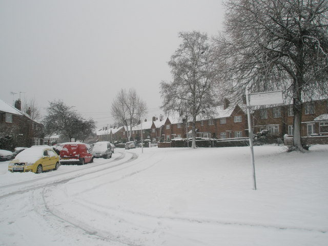 Junction of a snowy Woodgreen Avenue and Harestock Road