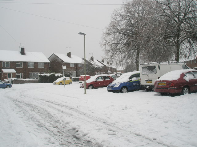 Looking from a snowy Harestock Road down to Woodgreen Avenue
