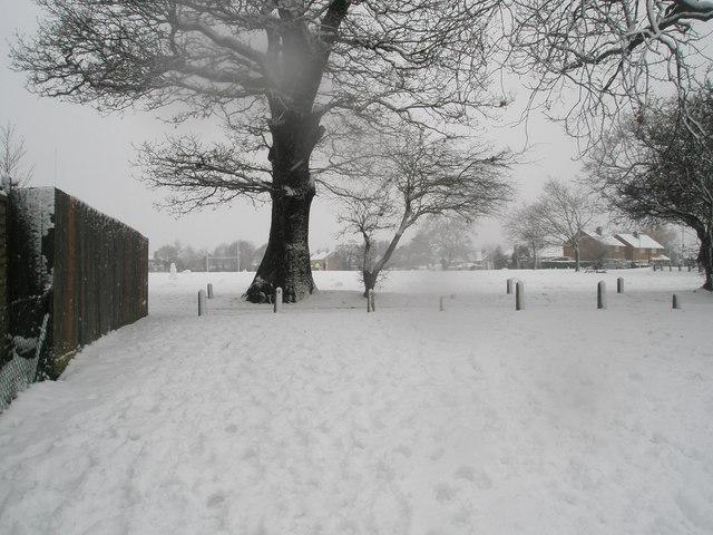 Looking from Harestock Road towards a snowy Hooks Lane Rec