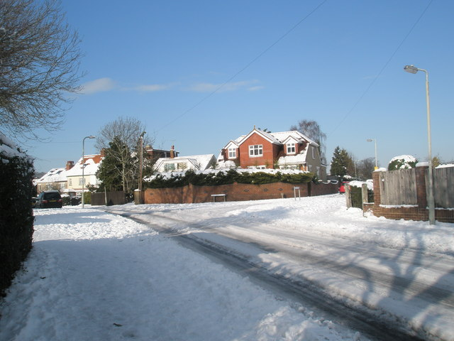 Approaching the junction of a snowy Scratchface Lane and Matthews Close