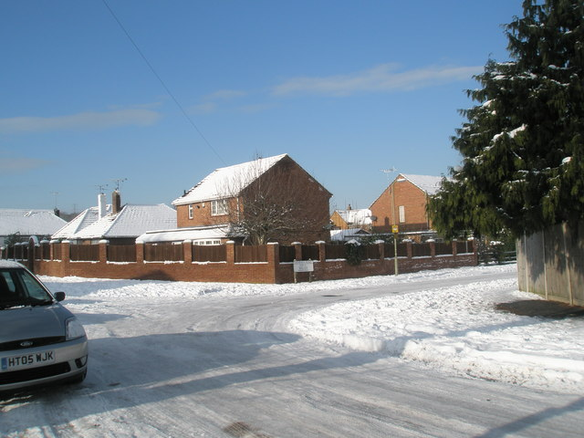 Approaching the junction of a snowy Scratchface Lane and Newbarn Road