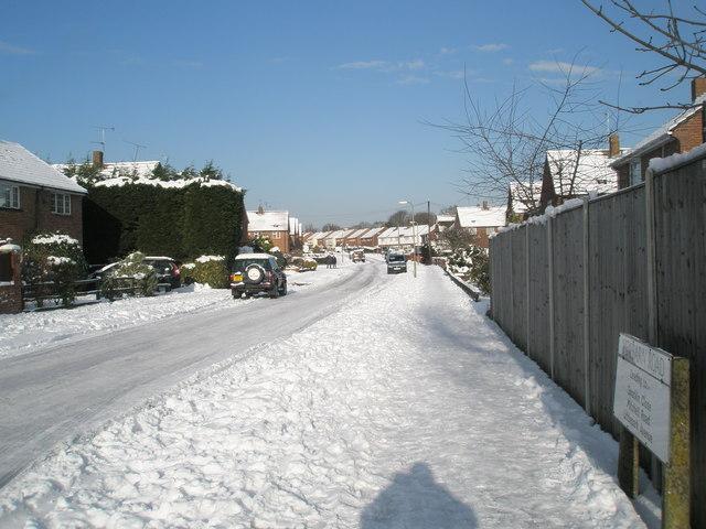 Looking along a snowy Newbarn Road