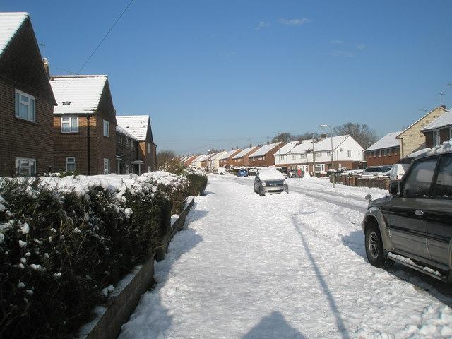 A snowy pavement in Newbarn Road