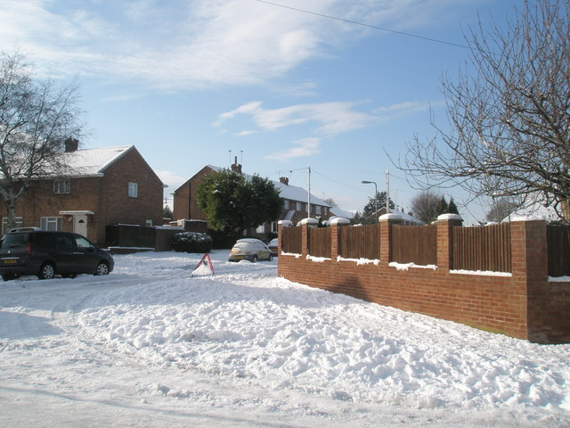 Looking from a snowy Newbarn Road into Scratchface Lane