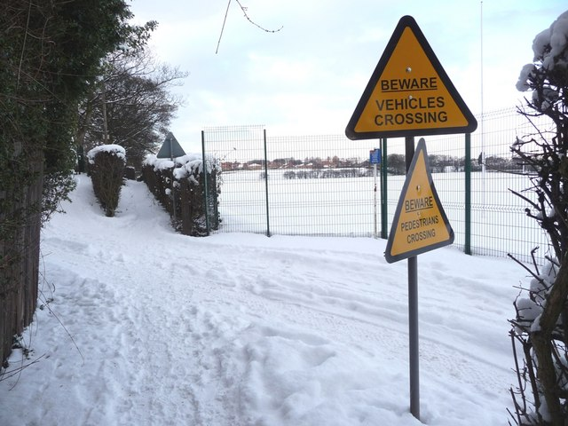 Warning signs, as footpath crosses private vehicle track