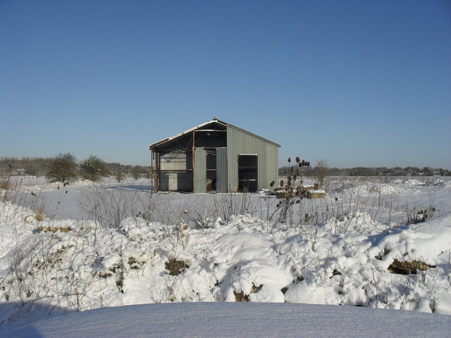 Derelict barn in the snow