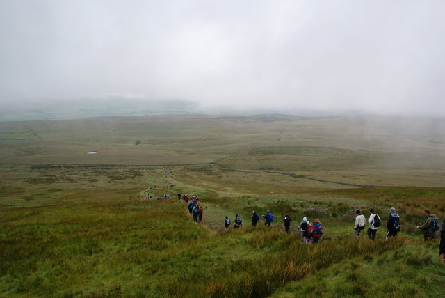 Charity walkers snaking across the moor