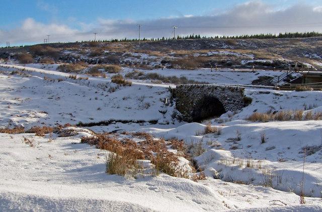 Old bridge in the snow
