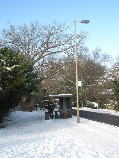 A snowy scene approaching the bus stop in Hulbert Road
