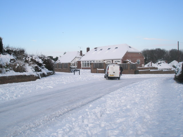 Van turning from a snowy Littlepark Avenue into Ashwood Close