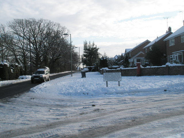 Junction of a snowy Littlepark Avenue and Hulbert Road