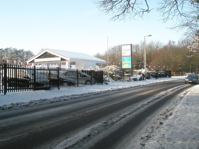 Approaching a snowy car dealership in Hulbert Road