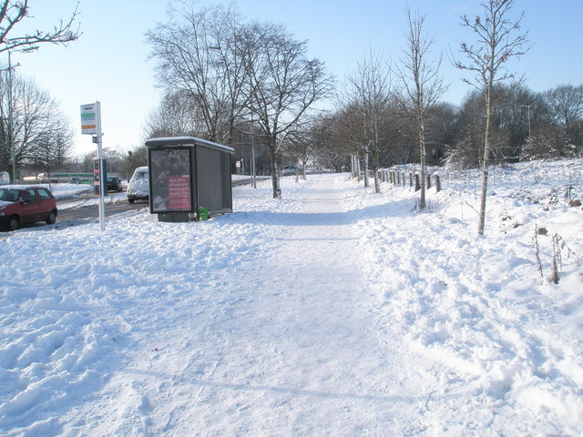 A snowy scene approaching a bus stop in Purbrook Way