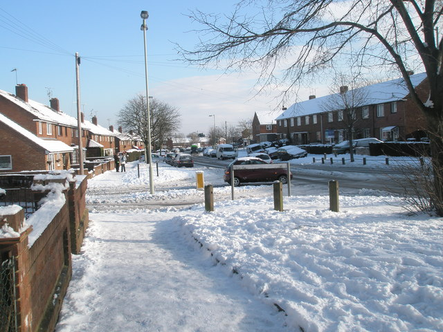 Approaching the junction of  a snowy Purbrook Way and Park House Farm Way