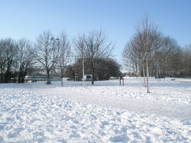 Looking across a snowy ASDA roundabout