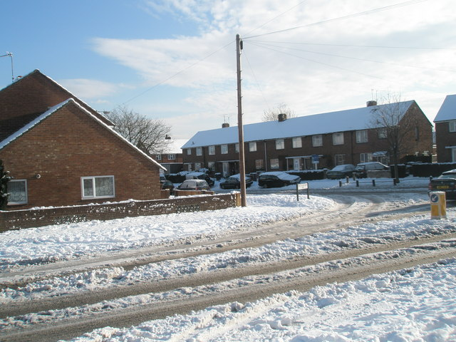 Approaching the junction of  a snowy Park House Farm Way and Purbrook Way