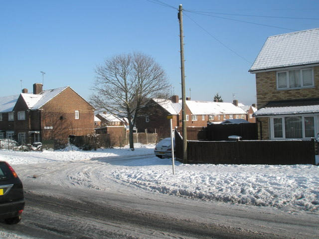 Approaching the junction of  a snowy Park House Farm Way and Hordle Road