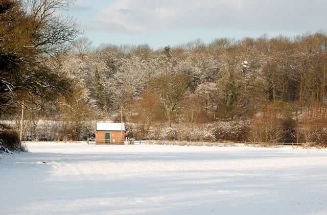 River Itchen gauging station seen across a snowy field