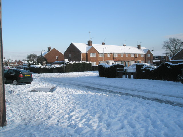 Approaching the junction of  a snowy Plaitford Grove and Grateley Crescent