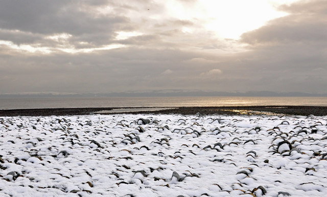Snow coated boulders on Llantwit Major beach