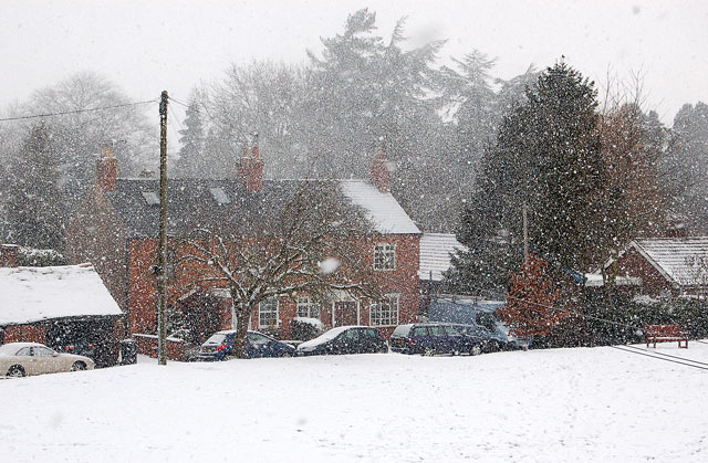 Snow falling over the village green, Broadwell