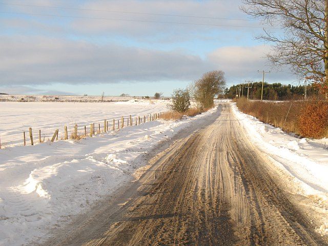 Snow covered minor road near Mawcarse