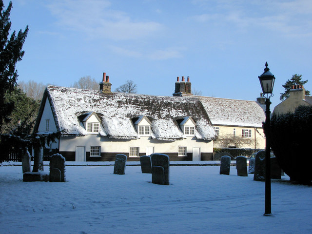 Trumpington: thatched cottages in the snow
