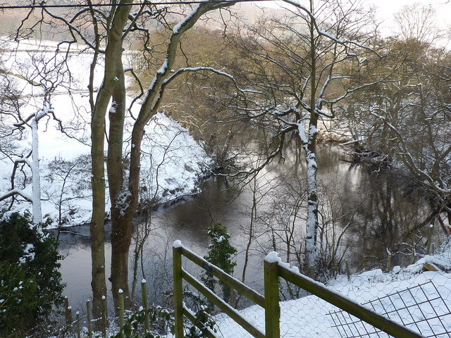 The snow covered banks of the River Derwent