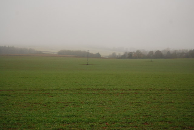 Telegraph pole in a very large field