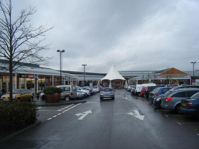 McArthur Glen Shopping Outlet from car park.