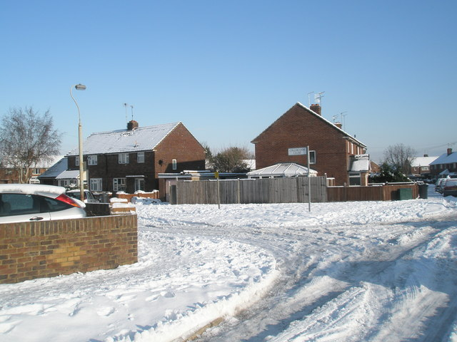 Approaching the junction of a snowy Grateley Crescent and Crookham Close