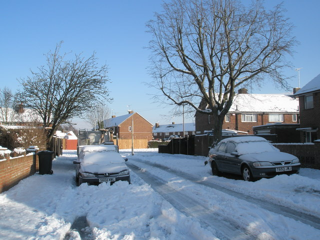 Approaching the junction of  a snowy Grateley Crescent and Linkenholt Way