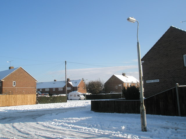 Looking from Grtaeley Crescent across a snowy Linkenholt Way towards Colbury Grove