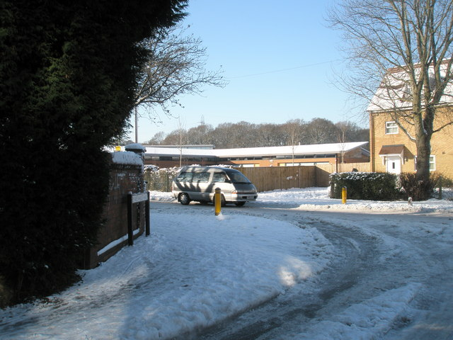 Looking from a snowy Linkenholt Way into Park House Farm Way