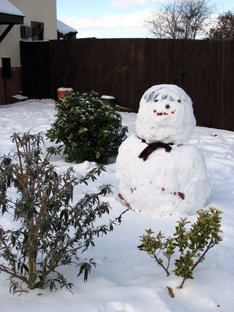 Smiling snowman in garden by junction of Norwich Road/The Ramblers