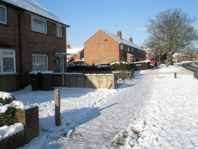 Approaching the junction of  a snowy Middle Park Way and Thruxton Road