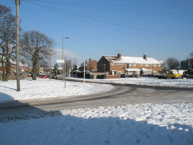 Junction of Park House Farm Way and a snowy Middle Park Way