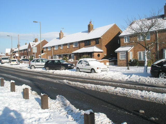 Snow covered homes in Middle Park Way