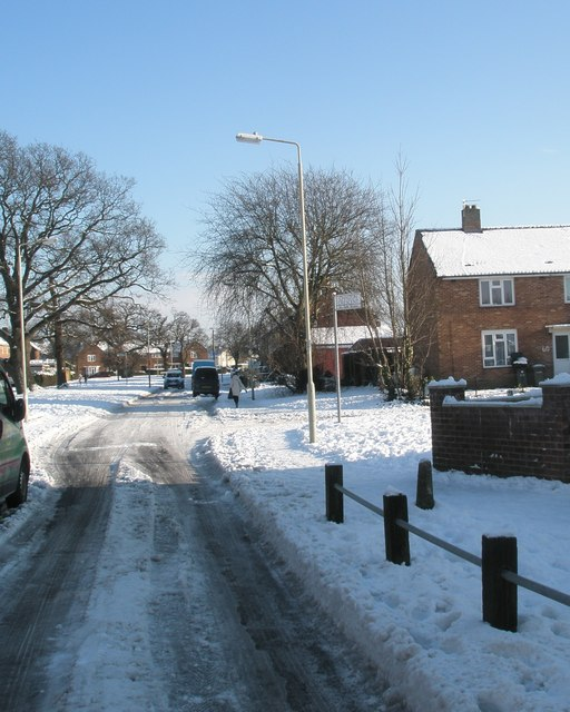 Approaching the junction of  a snowy Selborne Avenue and Chalton Crescent