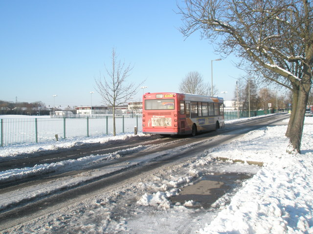 Bus passing a snowy Park Community School