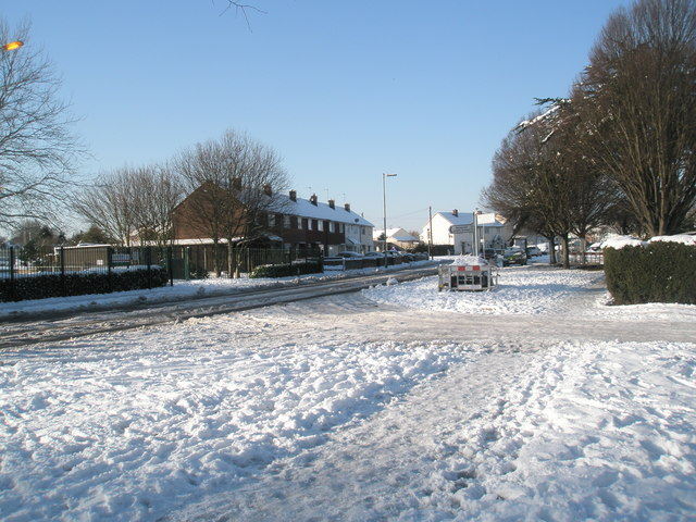 The junction of Barncroft Way and Priorsdean Crescent on a snowy January afternoon