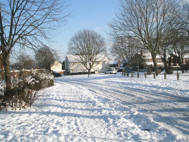 Looking from a snowy Hooks Farm Way towards Harestock Road