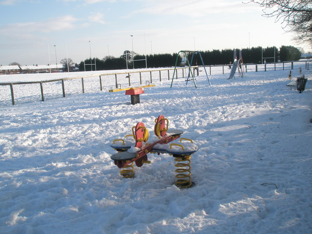 An empty playpark within a snowy Hooks Lane Rec